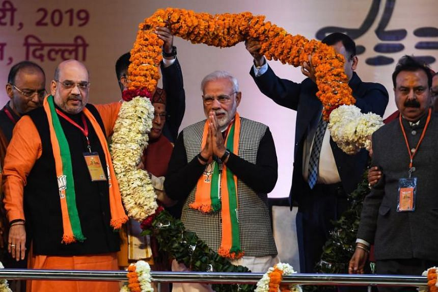 Indian Prime Minister Narendra Modi (centre) receives a garland from BJP leaders on the first day of the two-day Bharatiya Janata Party national convention in New Delhi on Jan 11, 2019.