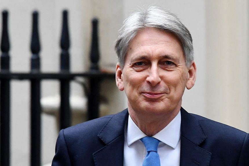 """Hammond (above) also warned that failing to agree a """"negotiated Brexit"""" could lead to instability and populism."""