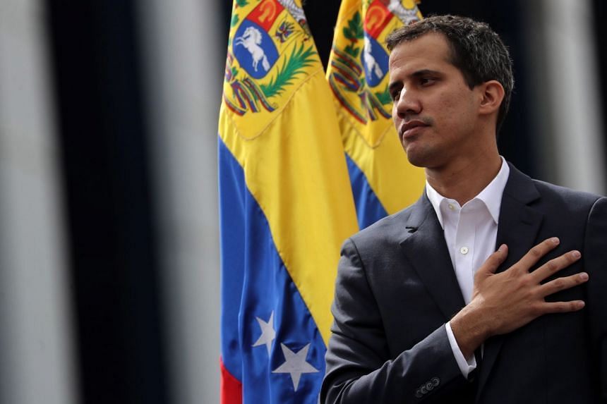 Guaido posing for photos after announcing that he is assuming executive powers, in Caracas.
