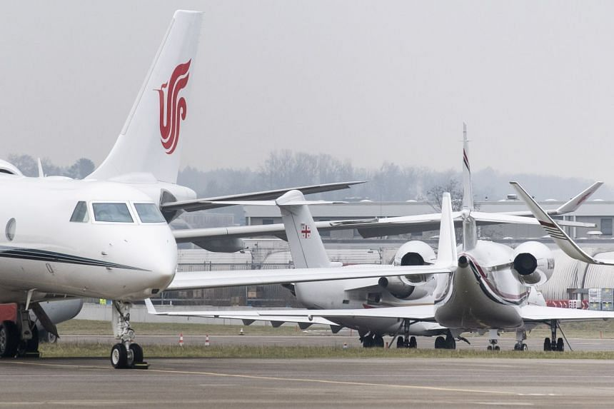 Private aircraft of WEF visitors stand on the tarmac of Zurich Airport in Ruemlang, Switzerland.
