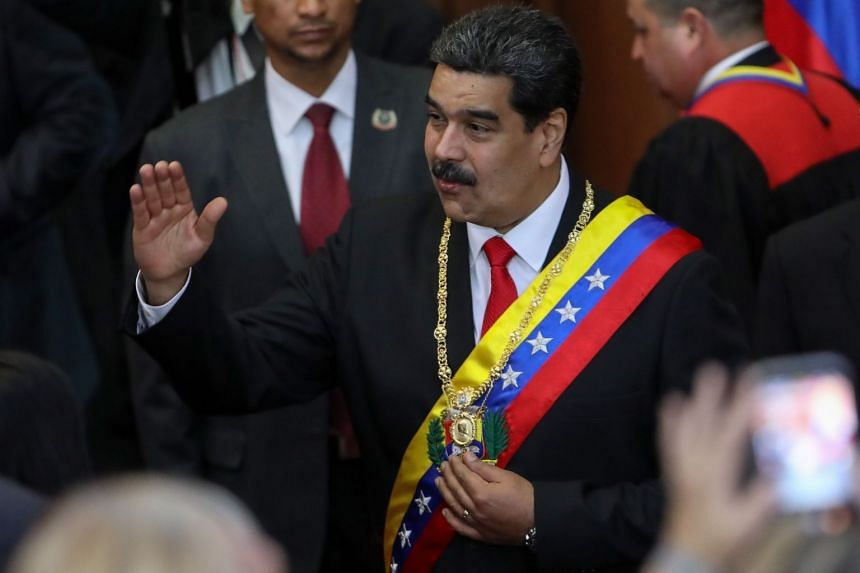 Maduro (centre) arrives at the opening ceremony of the judicial year, in Caracas, Venezuela, Jan 24, 2019.