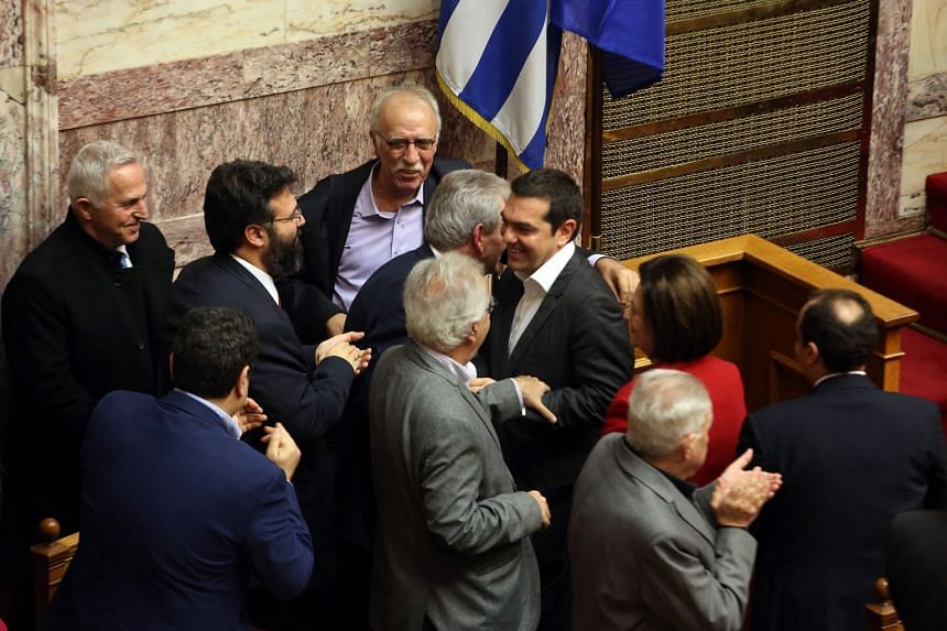 Greek Prime Minister Alexis Tsipras celebrates after the voting of the Prespes Agreement in Greek Parliament in Athens. The agreement was ratified by the Greek parliament with a majority of 153 votes, with 146 voting against and one deputy abstaining
