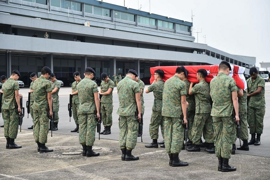 Gunners from the artillery formation paying their highest compliment to CFC (NS) Pang during the homecoming ramp ceremony. PHOTO: MINISTRY OF DEFENCE