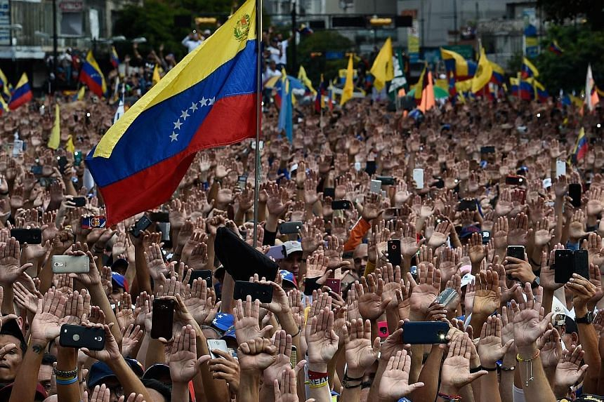 Protesters at a rally on Wednesday against Venezuelan President Nicolas Maduro, who was re-elected in May in elections boycotted by the opposition and denounced around the world as illegitimate.