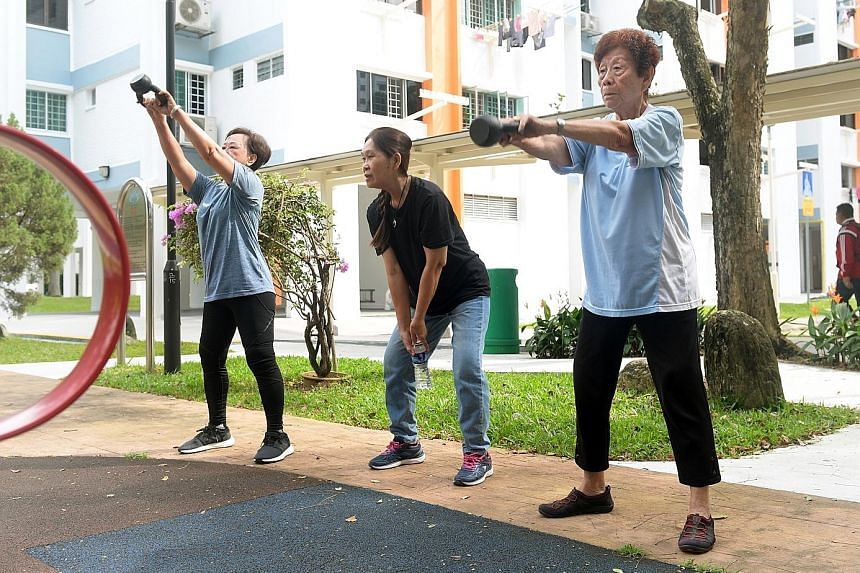 Yeoh Kim Bee (far right) and 10 other seniors are part of the CrossFit programme at the House of Joy elderly activities centre in Mountbatten. The exercise classes aim to give the elderly the confidence to lead independent lives. SCAN TO WATCH Meet t