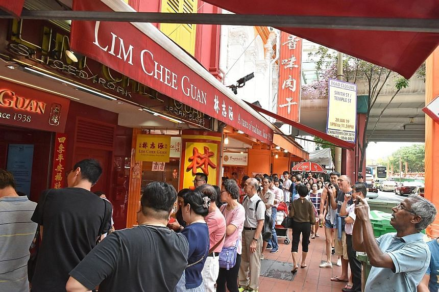 With Chinese New Year less than two weeks away, long queues can be seen at popular Chinatown bak kwa outlets, such as Lim Chee Guan, whose signature pork slices for the day were sold out by lunchtime yesterday, though there were still many customers