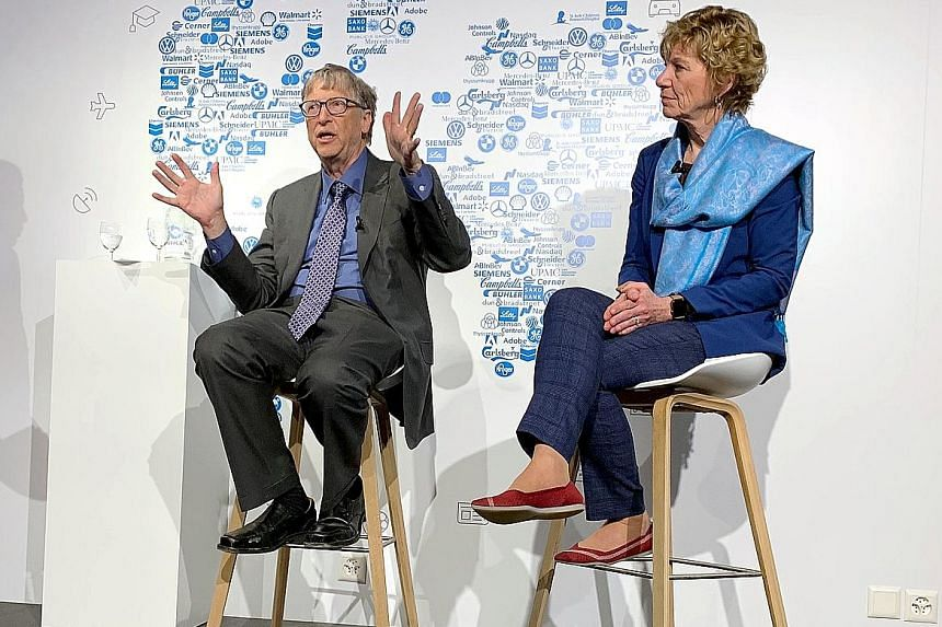 Billionaire philanthropist Bill Gates at an informal discussion in Davos on Wednesday joined by Dr Susan Desmond-Hellmann, CEO of the Bill & Melinda Gates Foundation.