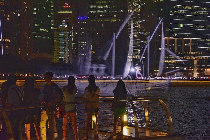 "A holographic boat ""docked"" at Marina Bay is one of 33 artworks that will go on display from next week as part of the upcoming festival i Light Singapore - Bicentennial Edition. Sails Aloft, created by the Estonia-based Biangle Studio, was inspired b"