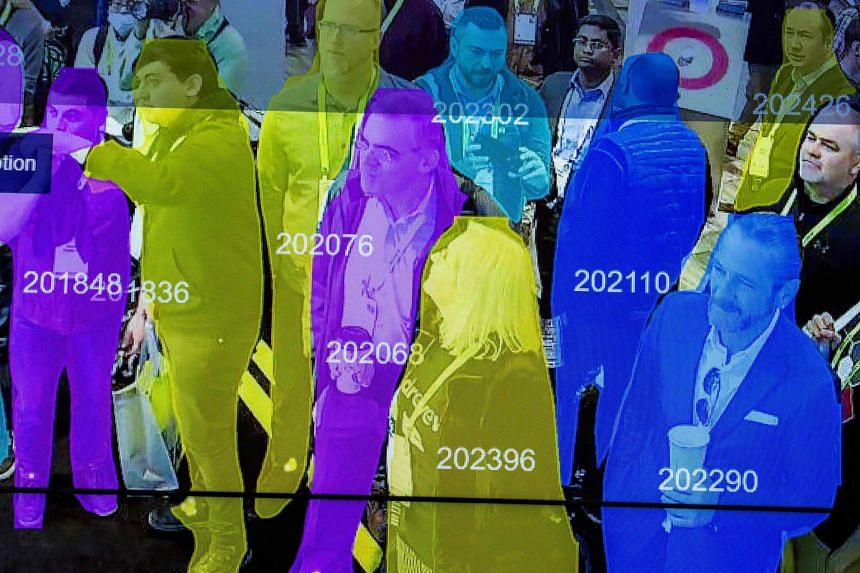 A live demonstration uses artificial intelligence and facial recognition in dense crowd spatial-temporal technology at CES 2019 in Las Vegas on Jan 10, 2019.