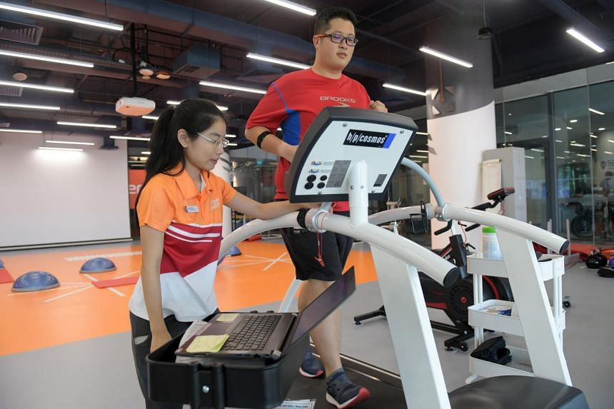 Mr Joseph Chen, 27, is assisted by Ms Jasmine Tan, 30, an Active Health Expert from the Active Health Lab, during a treadmill exercise designed to bring his heart rate up to a specified intensity, on March 6, 2018.