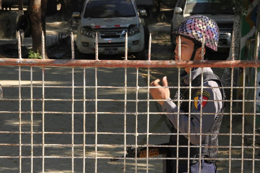 A policeman guards the police station in Inn Din in the Rakhine state on Jan 24, 2019.