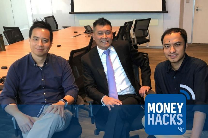 Mr Anthony Seow - head of unsecured loans and cards for DBS Bank - gives Money Hacks podcast hosts Chris Lim (left) and Ernest Luis (right) his top money and travel hacks.