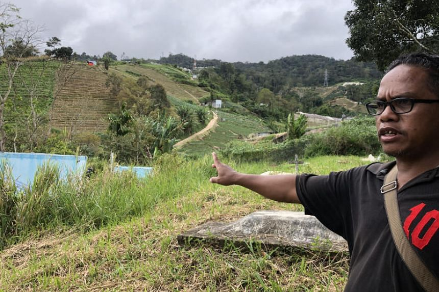 Seman Bahtom, an Orang Asli living in the Sungai Tiang village points out to the farm that borders onto the village area, leaving locals with only a small plot of land as the cemetery.