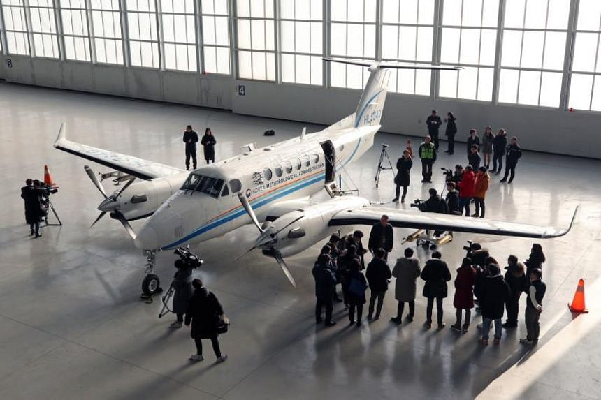 An aircraft that disperses silver iodide, a compound believed to cause rain to fall, at Gimpo airport in Seoul, on Jan 24, 2019.