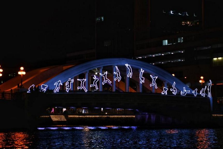 Turin-born artist Angelo Bonello created a series of LED figures in different stages of a leap on the Elgin Bridge over the Singapore River.