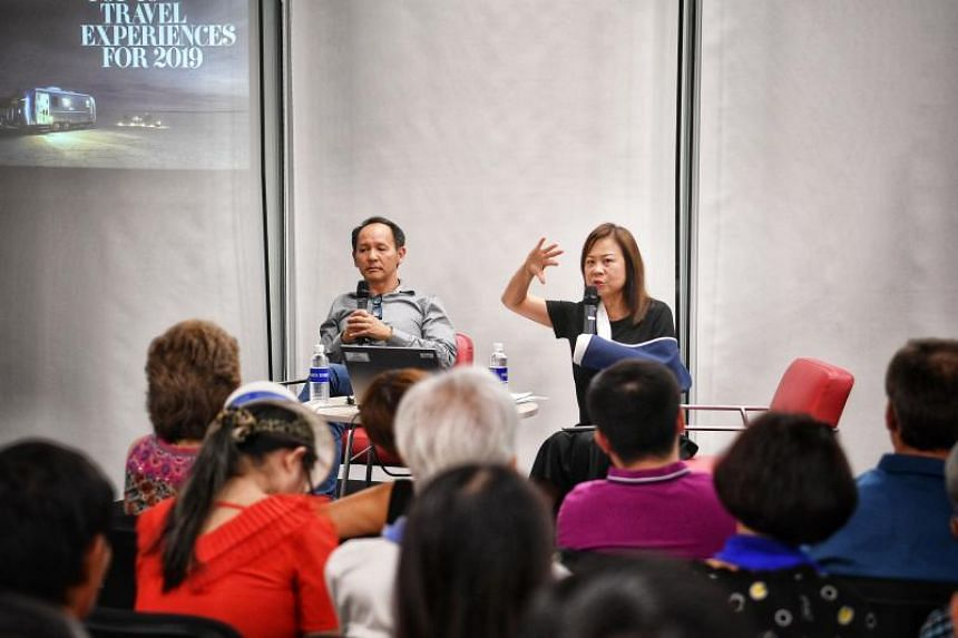 ST travel writer Lee Siew Hua  and guest speaker Chang Theng Hwee, CEO of Scott Dunn Asia, at a talk about the Top 10 travel experiences for 2019 at the Central Public Library on Jan 25, 2019.