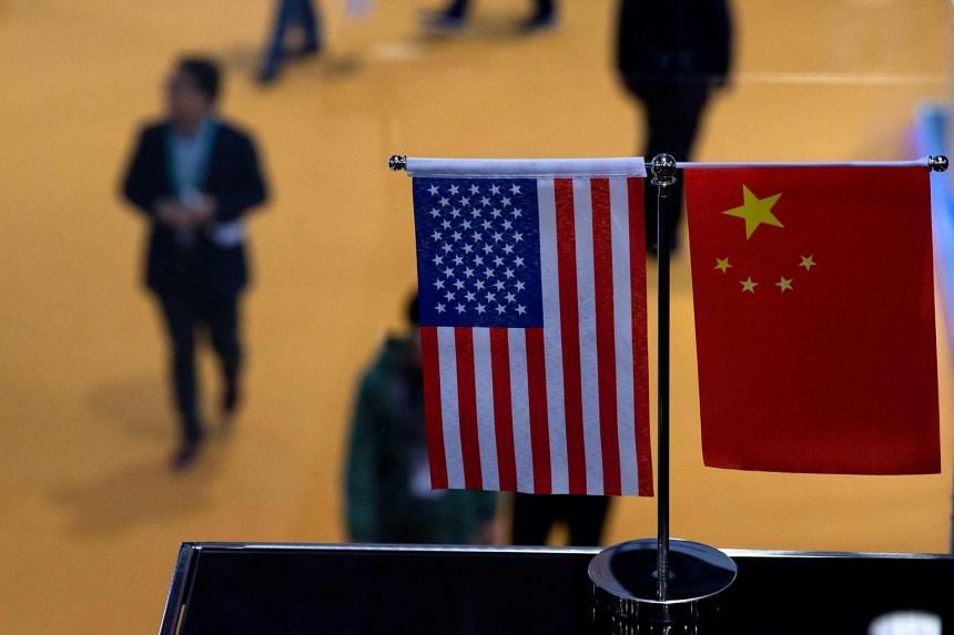 A Chinese and US flag at a booth during the first China International Import Expo in Shanghai, China, on Nov 6, 2018.