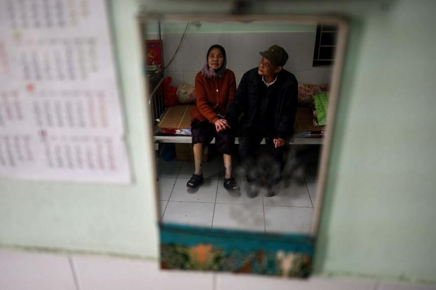 Leprosy survivors Nguyen Thi Teo (left) and wife Tran Huu Hoa holding hands at the Van Mon Leprosy hospice compound, northern Vietnam's oldest leprosy hospital, on Jan 10, 2019.