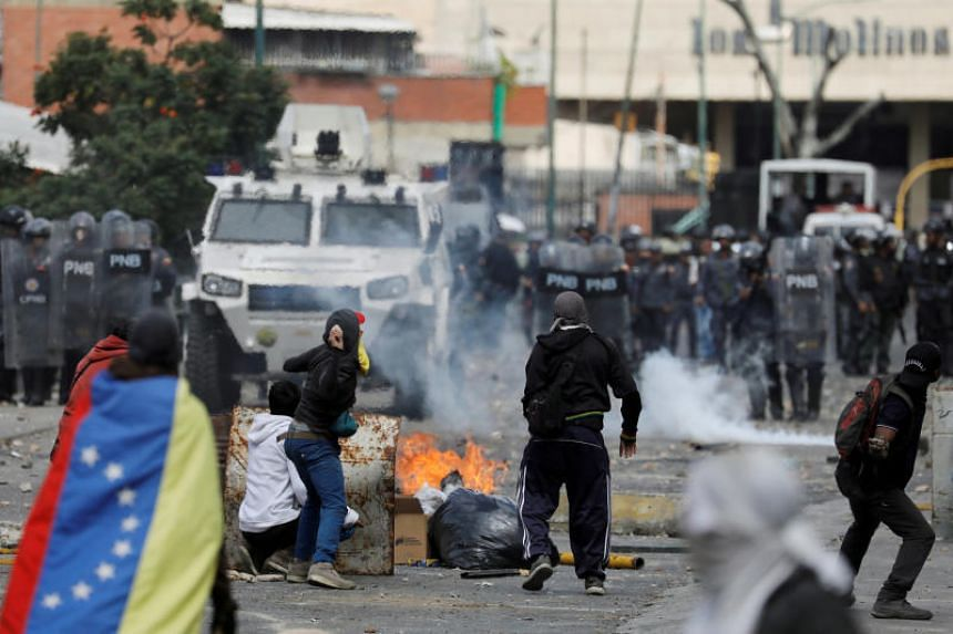 Demonstrators clash with police during a protest against Venezuelan President Nicolas Maduro's government in Caracas, Venezuela, on Jan 23, 2019.
