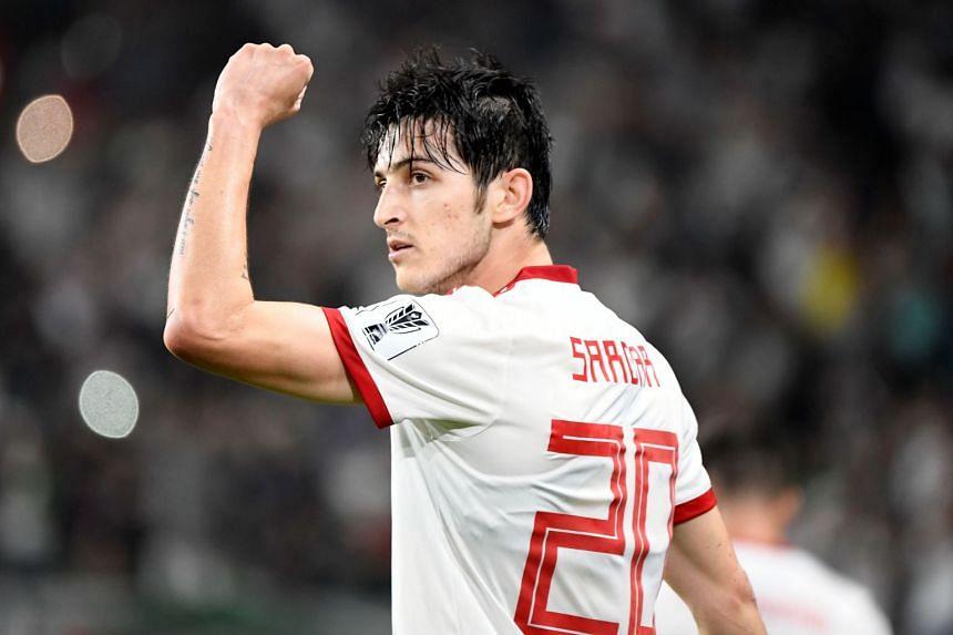Iran's forward Sardar Azmoun celebrates his goal.