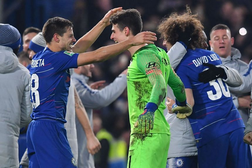 Chelsea's Cesar Azpilicueta (left) celebrates with Kepa Arrizabalaga on the pitch after winning the penalty shoot-out.