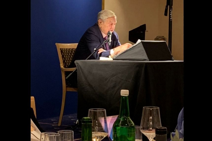 George Soros addressing a dinner audience on the margins of the World Economic Forum in Davos.