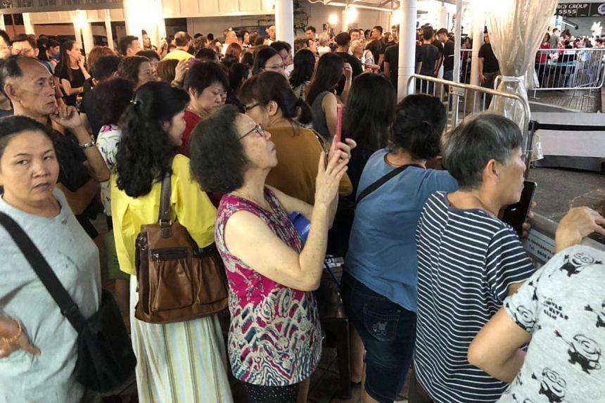 A crowd gathering at the wake of Aloysius Pang in MacPherson Lane, on Jan 25, 2019.