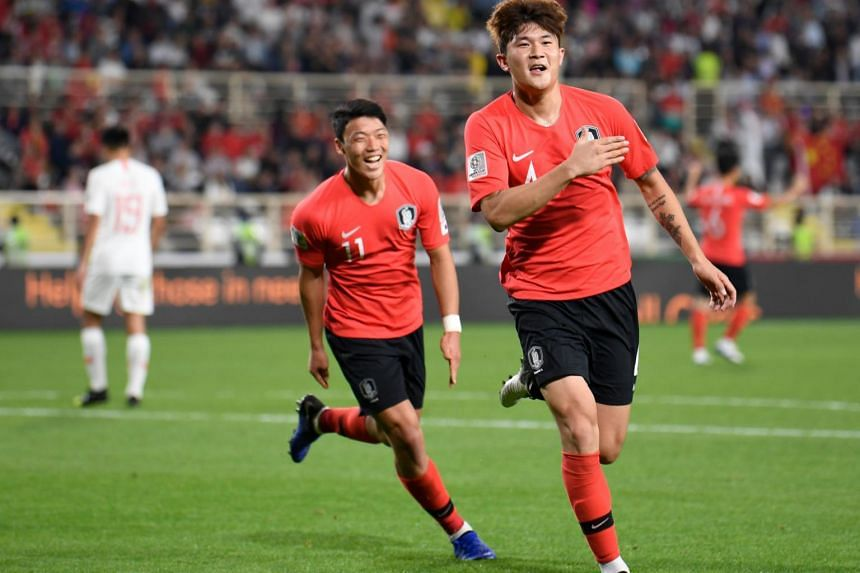 South Korea's defender Kim Min-jae (right) celebrates after scoring a goal during the 2019 AFC Asian Cup group C football match between South Korea and China on Jan 16, 2019.