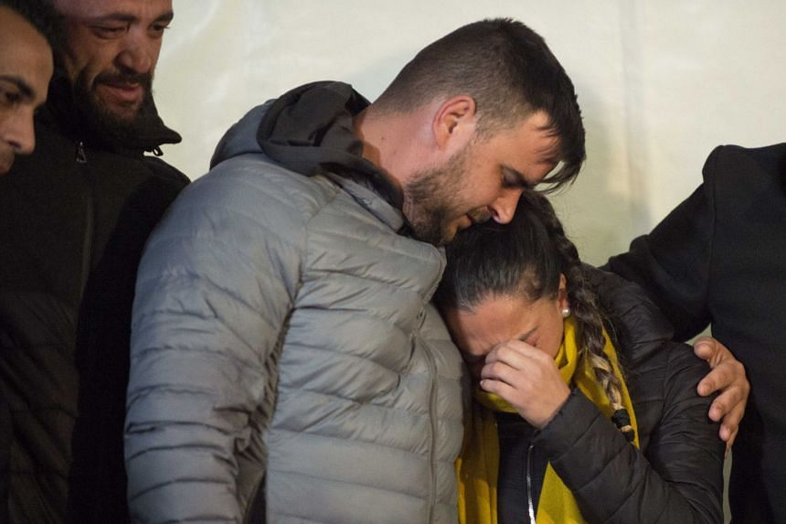 Parents of two-year-old Julen Rosello hug in Totalan, southern Spain, on Jan 24, 2019.