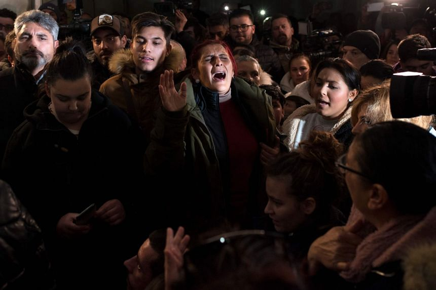 Women sing during a vigil in support of two-year-old Julen Rosello and his parents in Totalan, southern Spain.