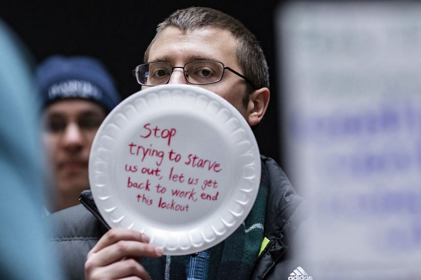 A demonstrator holds a sign during a protest by Federal employees in Washington, on Jan 23, 2019.