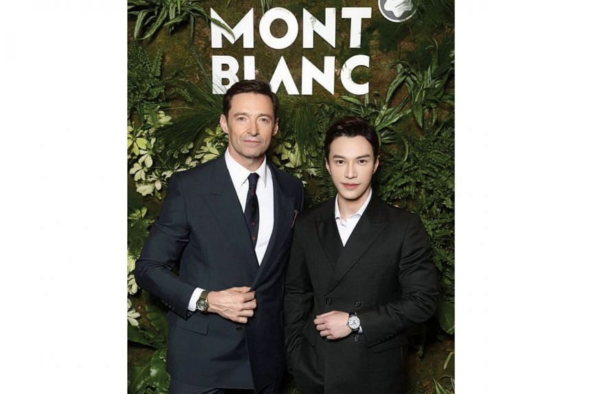"""Montblanc ambassador Hugh Jackman and Montblanc Malaysia """"friend of the brand"""" Lawrence Wong at the Salon International de la Haute Horlogerie. Jackman is wearing a Montblanc 1858 Geosphere, while Wong is sporting a Montblanc Star Legacy Full Cal"""