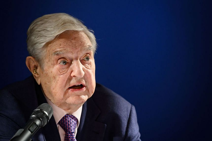 George Soros delivers a speech on the sideline of the World Economic Forum annual meeting.