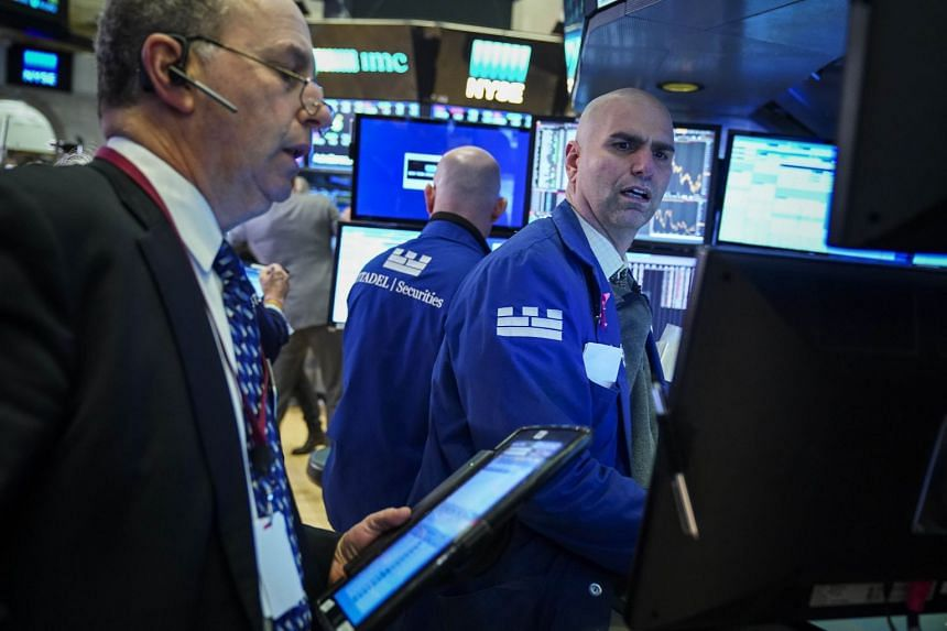 Traders work on the floor of the New York Stock Exchange on Jan 22, 2019.