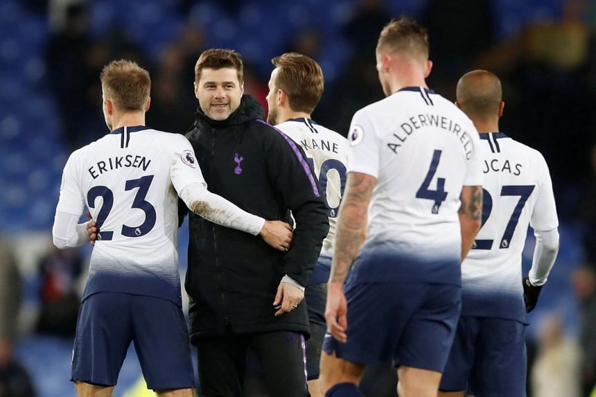 Tottenham's Christian Eriksen and Harry Kane celebrate with manager Mauricio Pochettino after a match.