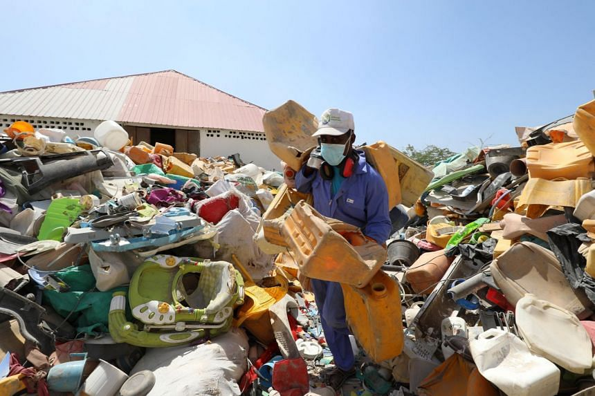 A man sorts plastic litter collected from a garbage dump to be recycled into roofing tiles in Mogadishu, Somalia.