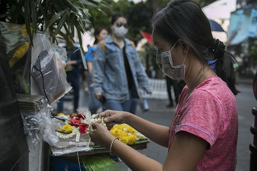 Bangkok residents wearing masks to protect themselves against the smog, which has been found to contain hazardous substances.