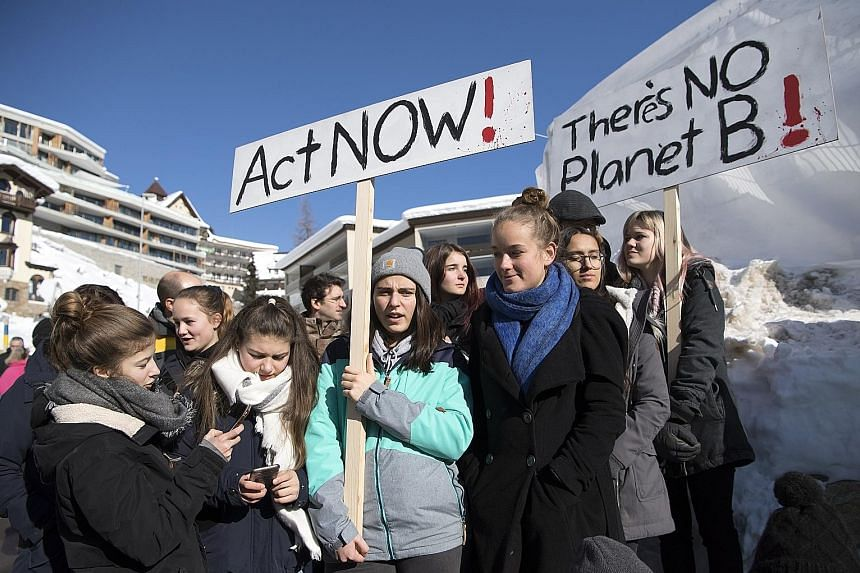 """Students taking part in a """"School Strike for Climate"""" outside the Davos Congress Centre yesterday. Aside from climate change, inequality and youth unemployment also featured in the final discussion of this year's World Economic Forum."""