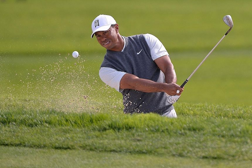 Tiger Woods hitting out of a bunker on the sixth hole during the first round of the Farmers Insurance Open at Torrey Pines' South Course on Thursday. The former world No. 1 shot a two-under 70.