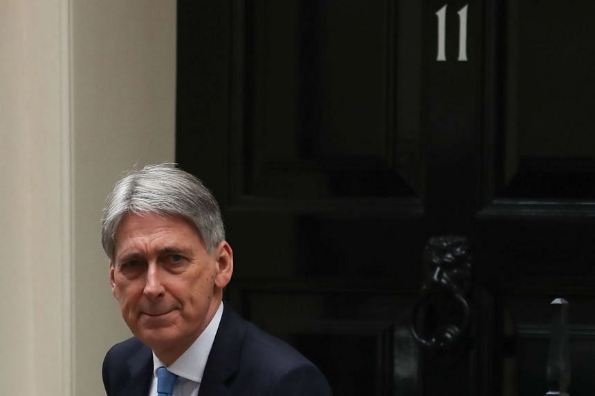 Britain's Chancellor of the Exchequer Philip Hammond is pictured outside 11 Downing Street in London.