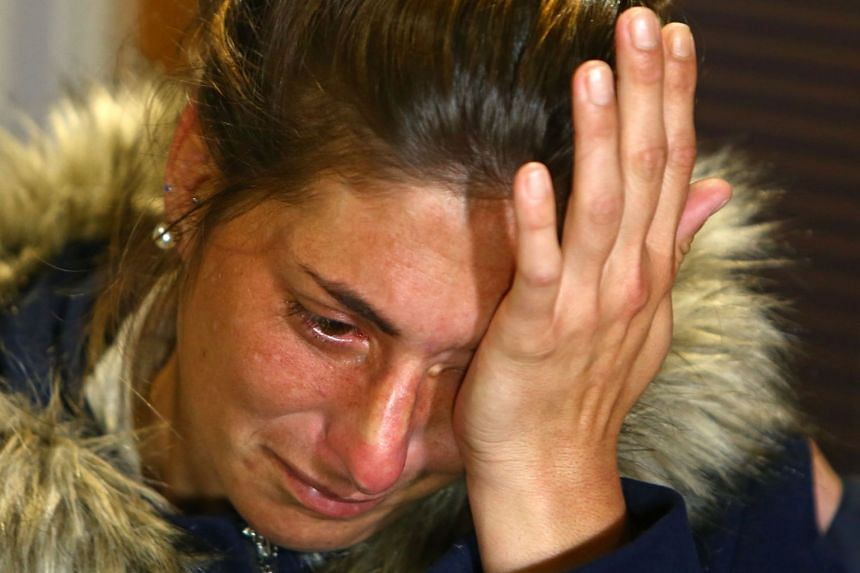 Romina Sala reacts as she holds a press conference at Cardiff City's stadium in Wales.