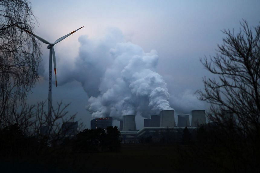 Water vapour rises from the cooling towers of a power plant in Jaenschwalde, Germany, on Jan 24, 2019.