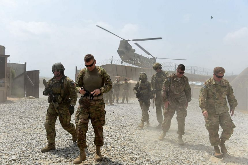 File photo showing US army soldiers and a military helicopter in Nangarhar, Afghanistan.