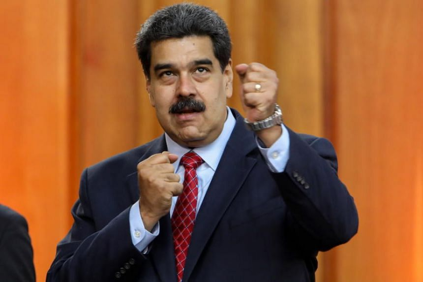 Venezuelan leader Nicolas Maduro gestures during a press conference at the Miraflores Palace in Caracas, Venezuela, on Jan 25, 2019.