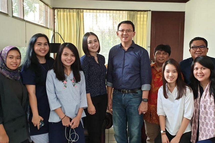 Former Jakarta governor Ahok (fifth from left) poses with his relatives and Puput Nastiti Devi (fourth from left) after being released from prison in Jakarta, Indonesia, on Jan 24, 2019
