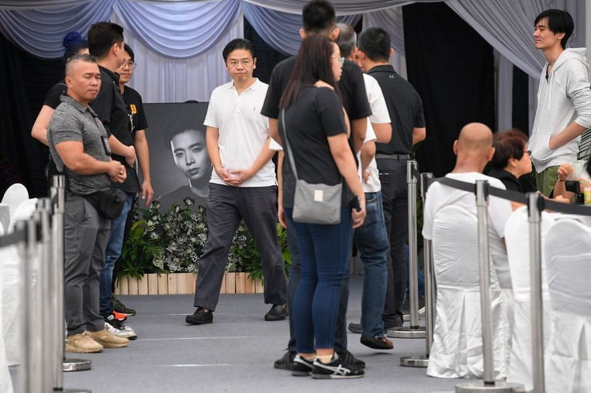 Minister for National Development Lawrence Wong paying his respects to late actor Aloysius Pang.
