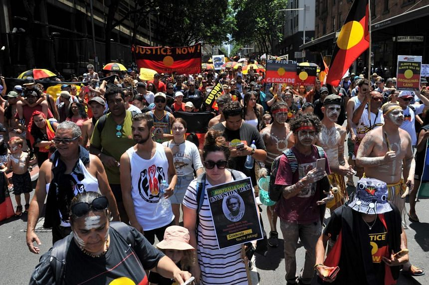 "Protesters marching through the streets of Sydney in an ""Invasion Day"" rally on Australia Day, on Jan 26, 2019."