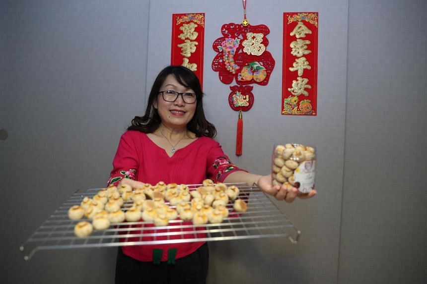 Mrs Belinda Foo with her homemade almond cookies, made from the recipe of a late distant relative.
