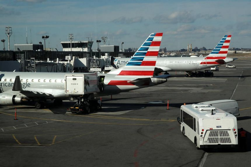Planes are seen parked at the terminal at LaGuardia Airport in New York City after hundreds of flights were grounded or delayed on Jan 25, 2019.