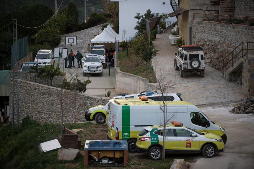 Rescue workers seen near the site where a child fell down a well in Totalan, southern Spain, on Jan 22, 2019.